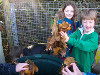 Children looking after the compost at St. Aidans School Ballintrillick